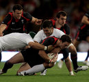 Wales wing George North is hauled to the floor
