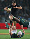 New Zealand's Richard Kahui attempts to hurdle the South Africa defence