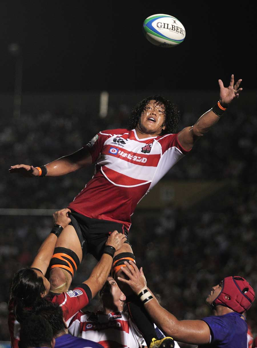 Japan's Takashi Kikutani reaches for the ball