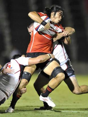 Japan's Itaru Taniguchi is tackled by a wall of US Eagles defenders, Japan v US Eagles, Prince Chichibu Memorial Rugby Ground, Tokyo, Japan, August 21, 2011