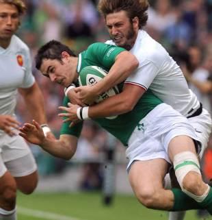 Ireland's Felix Jones is tackled by Maxime Medard, Ireland v France, Aviva Stadium, Dublin, Ireland, August 20, 2011