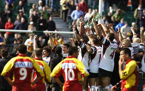 Perpignan players look on as Toukouse celebrate