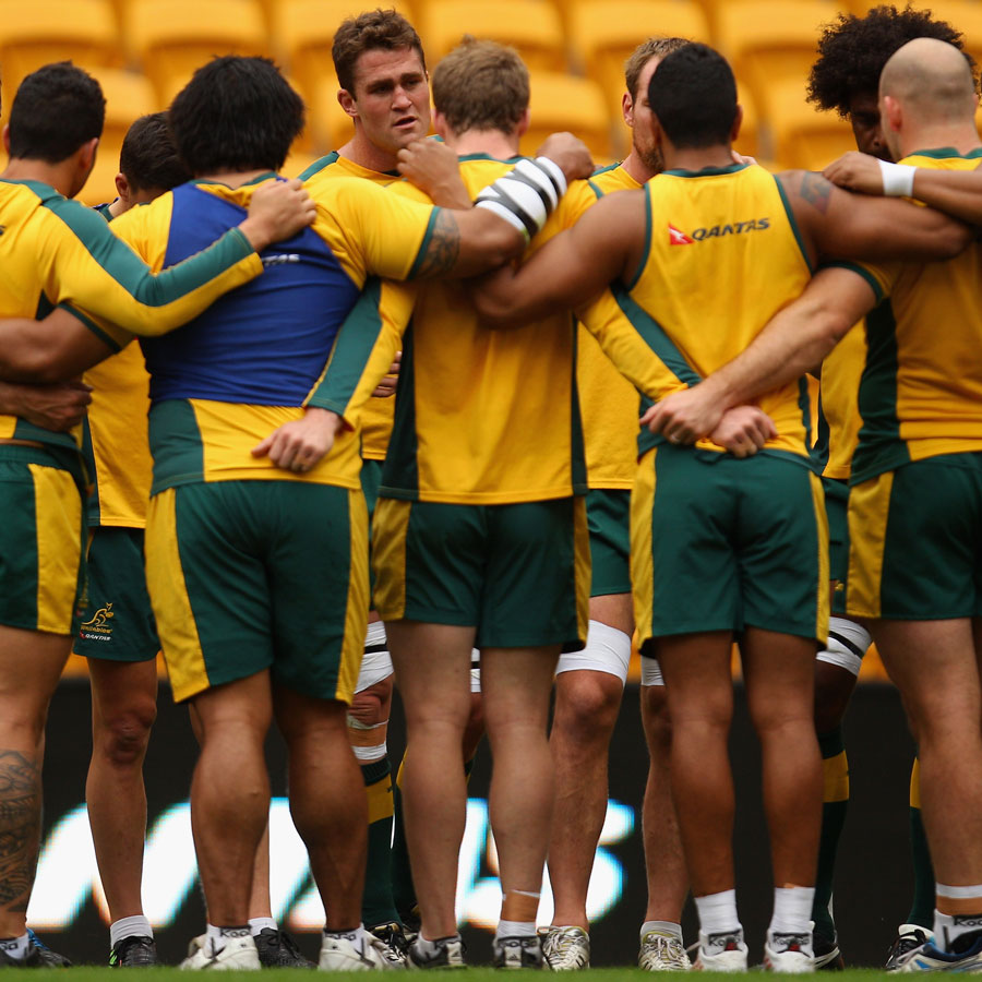 James Horwill speaks to his team-mates