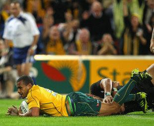 Wallabies scrum-half Will Genia slides over, Australia v New Zealand, Tri-Nations, Lang Park, Brisbane, Australia, August 27, 2011