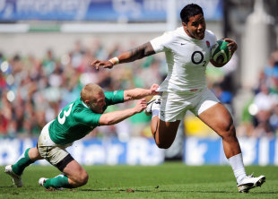 England centre Manu Tuilagi shrugs off a tackle by Keith Earls