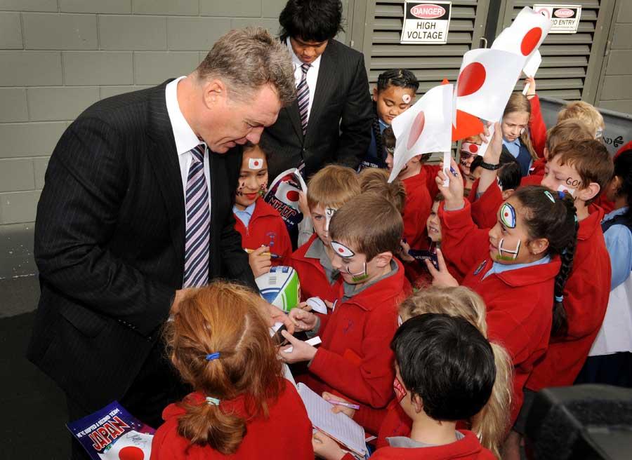 Japan's coach John Kirwan signs autographs