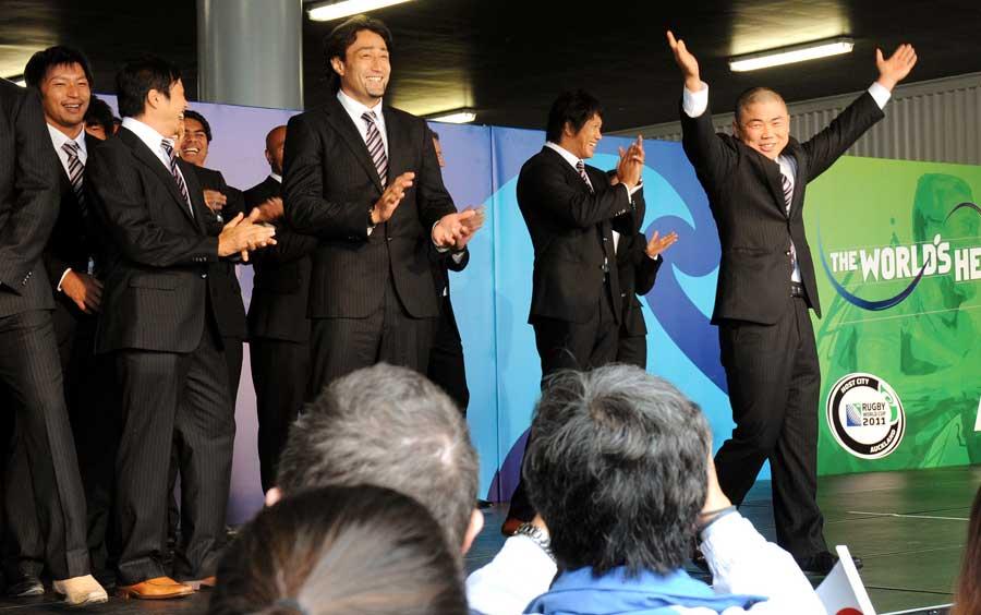 Japan's Fumiaki Tanaka dances as his team arrive in Auckland