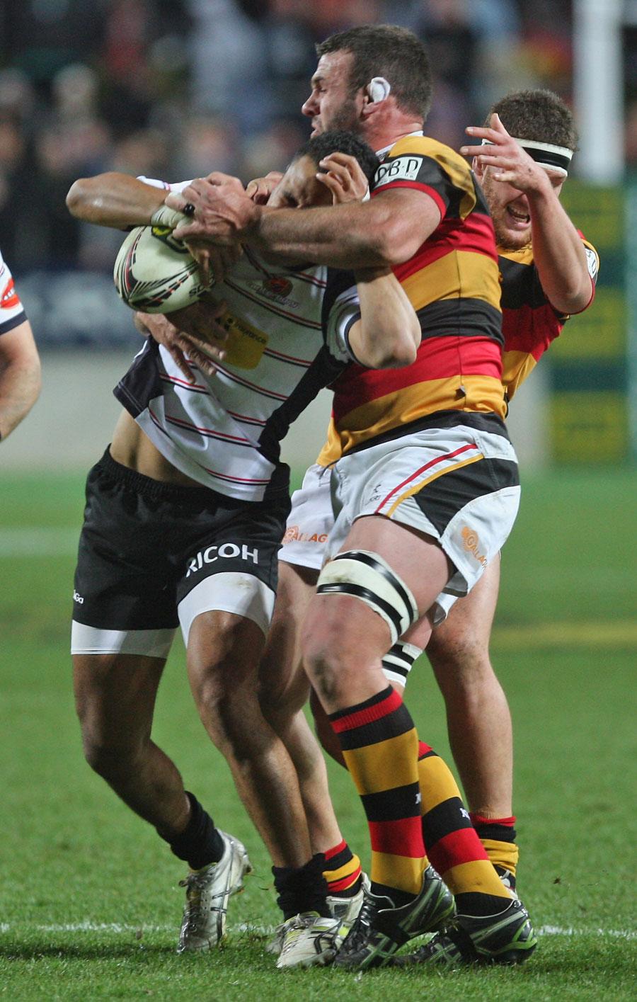 Waikato's Alex Bradley tackles Canterbury's Telusa Veainu