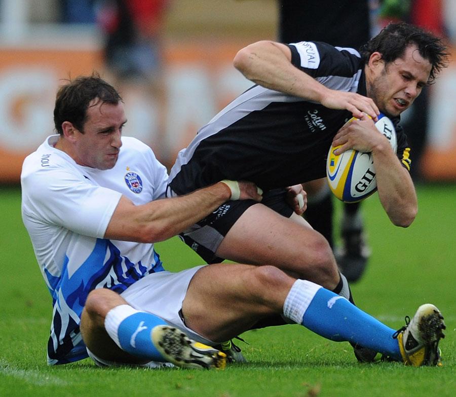 Newcastle's Luke Eves is taken down