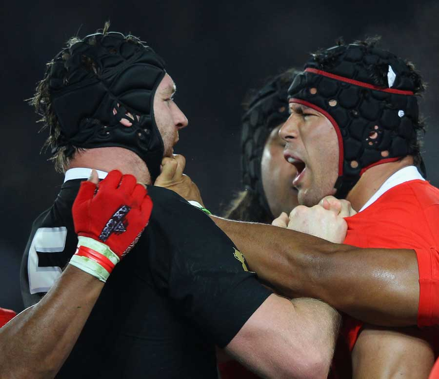 The All Blacks' Ali Williams gets up close and personal with Tonga's Joseph Tuineau, New Zealand v Tonga, Rugby World Cup, Eden Park, Auckland, New Zealand, September 9, 2011