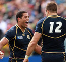 Scotland centre Joe Ansbro celebrates his try