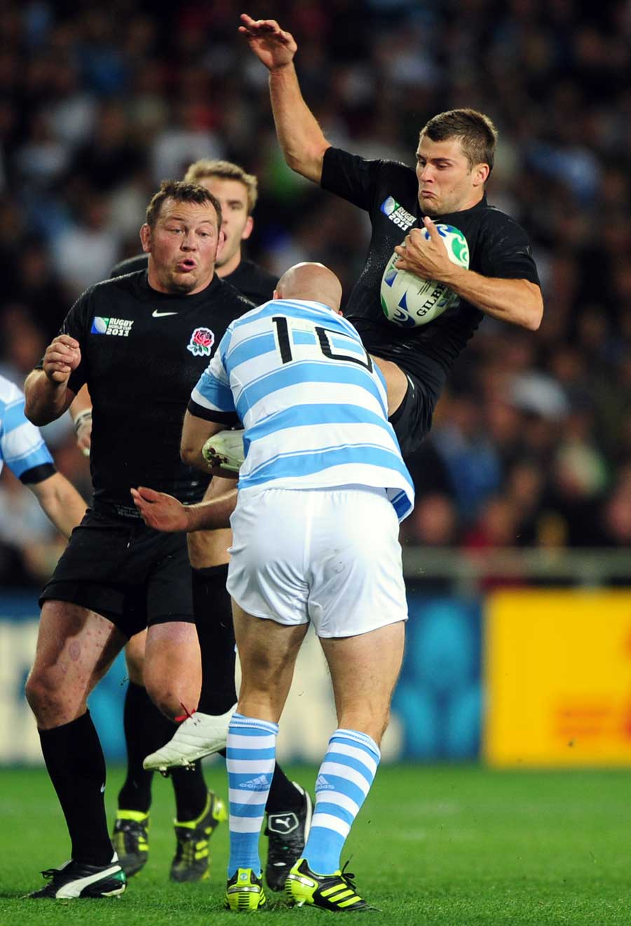 Argentina's Felipe Contepomi catches Richard Wigglesworth in the air
