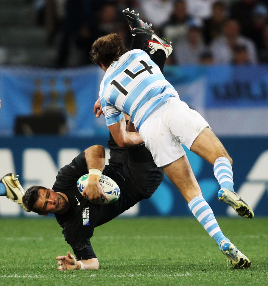 England's Ben Foden is tackled by Argentina's Gonzalo Camacho