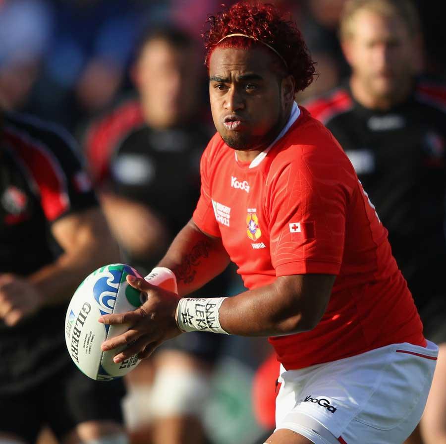 Tonga's Taniela Moa looks to shift the ball
