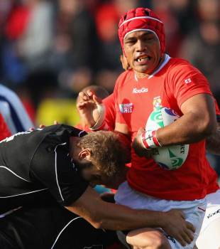 Tonga's Sione Timani feels the force of Jebb Sinclair
