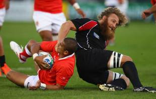 Canada's Adam Kleeberger tangles with Tonga's Thomas Palu