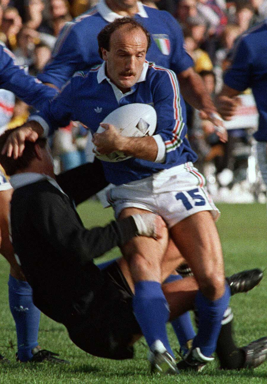 Italy's Serafino Ghizzoni is tackled by a Kiwi player