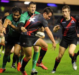 Edinburgh's Lee Jones pumps his legs against Connacht