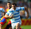 Argentina's Santiago Fernandez bursts through to score the opening try