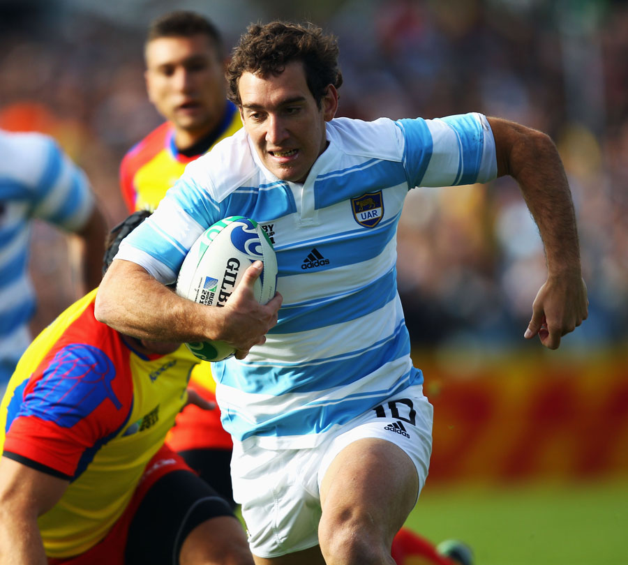 Argentina's Santiago Fernandez powers away for a try