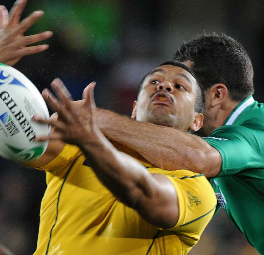 Australia's Kurtley Beale feels the full force of Ireland's Rob Kearney