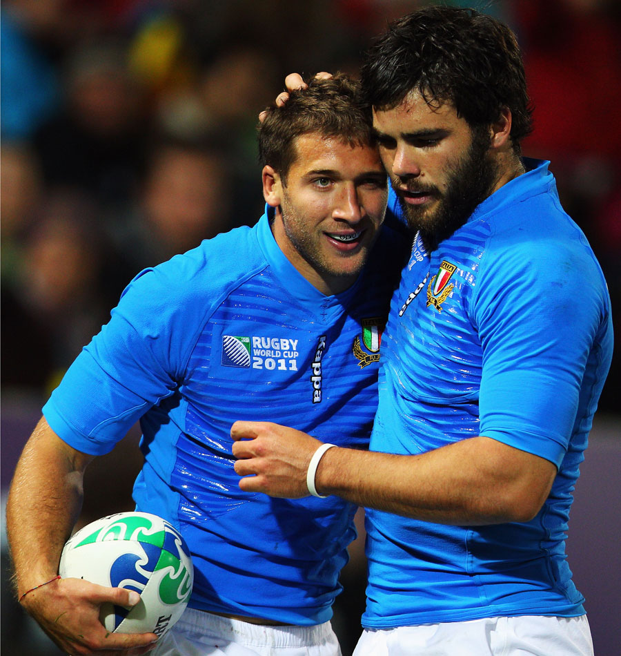 Italy's Tommaso Benvenuti and Luke McLean celebrate another try