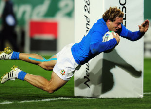 Italy's Giulio Toniolatti dives in to score his second try