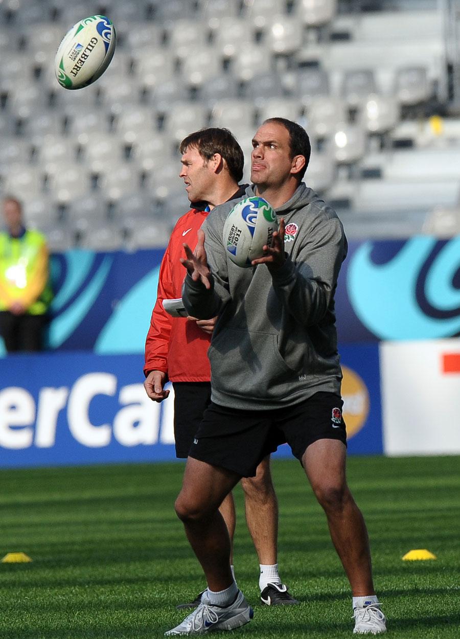 England boss Martin Johnson juggles the balls during training