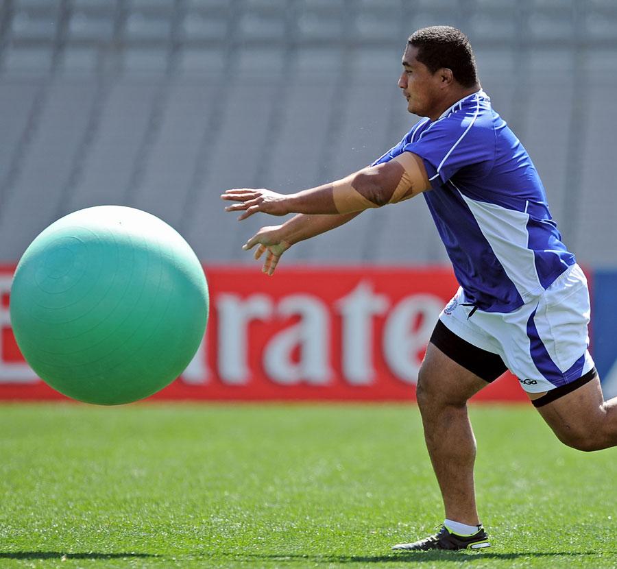 Samoa's Sakaria Taulafo chases after a slightly bigger ball than usual