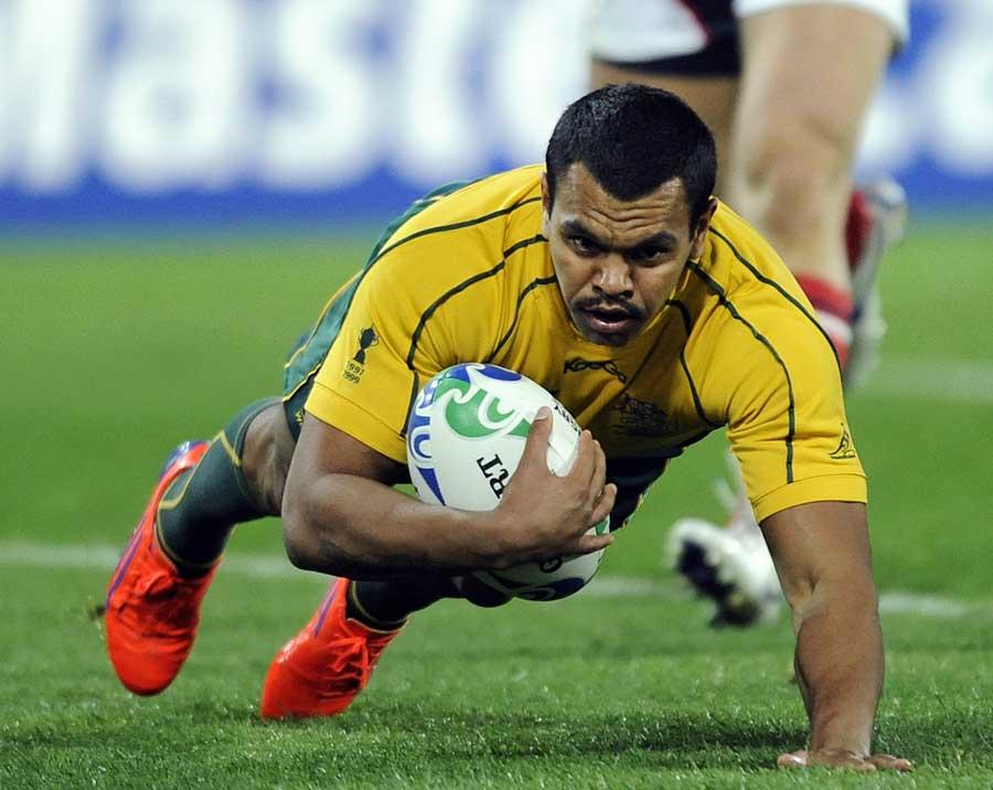 Australia's Kurtley Beale crosses the tryline