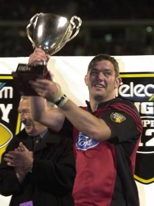 Reuben Thorne lifts the 2002 Super 12 trophy