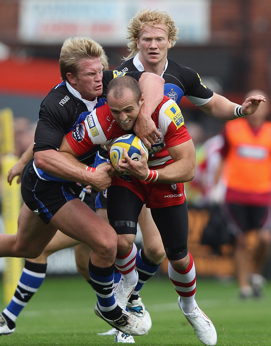 Gloucester winger Charlie Sharples is set upon by Bath's Michael Claassens