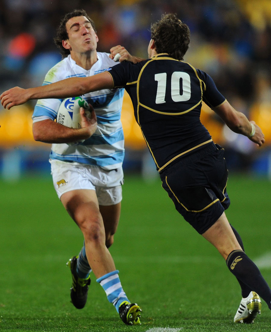 Argentina's Santiago Fernandez is stopped by Scotland's Ruaridh Jackson