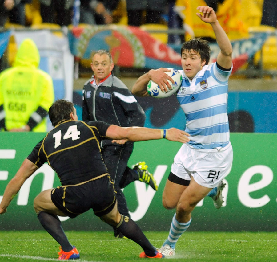 Argentina's Lucas Amorosino steps inside Chris Paterson