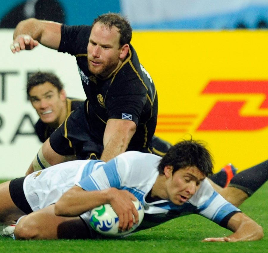 Argentina's Lucas Amorosino slides in to score the vital try