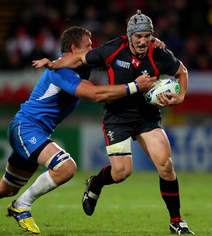 Wales centre Jon Davies holds off Namibia's Heinz Koll