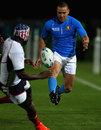 Italy's Fabio Semezato chips ahead