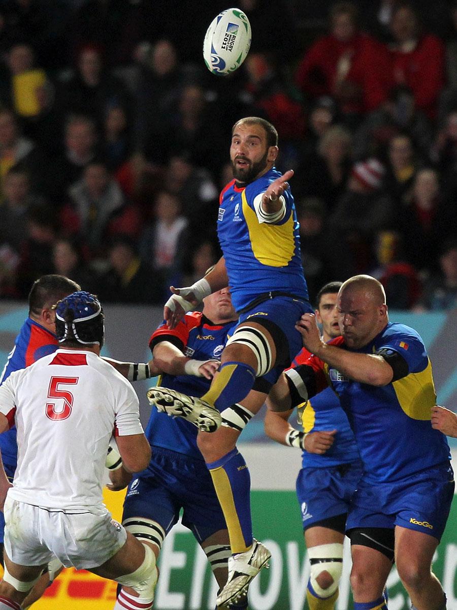 Romania's Valentin Neculai Ursache stretches for the ball