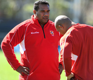 Tonga's coach Isitolo Maka talks to one of his players during a training session, Wellington, New Zealand, September 29, 2011