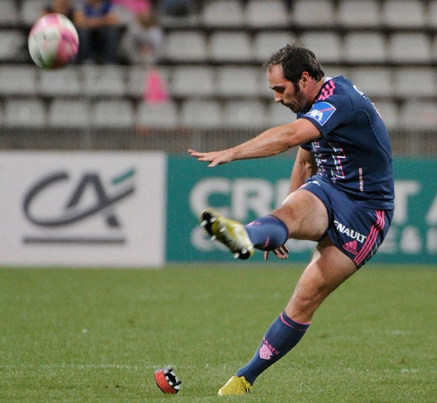 Stade Francais scrum-half Julien Dupuy kicks a penalty