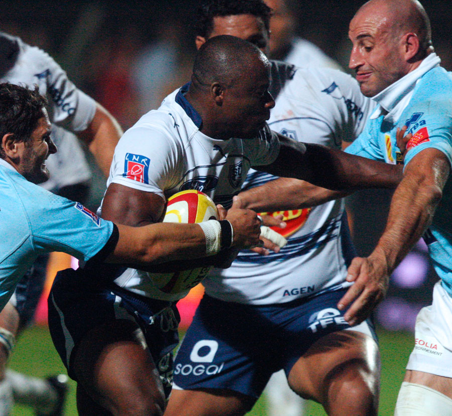 Agen fullback Silvere Tian takes on the Perpignan defence