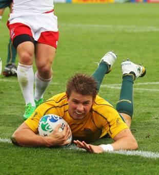 Australia's Drew Mitchell slides across the tryline