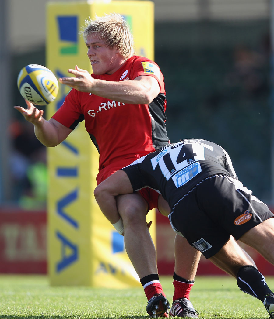 Saracens prop Rhys Gill offloads in the tackle