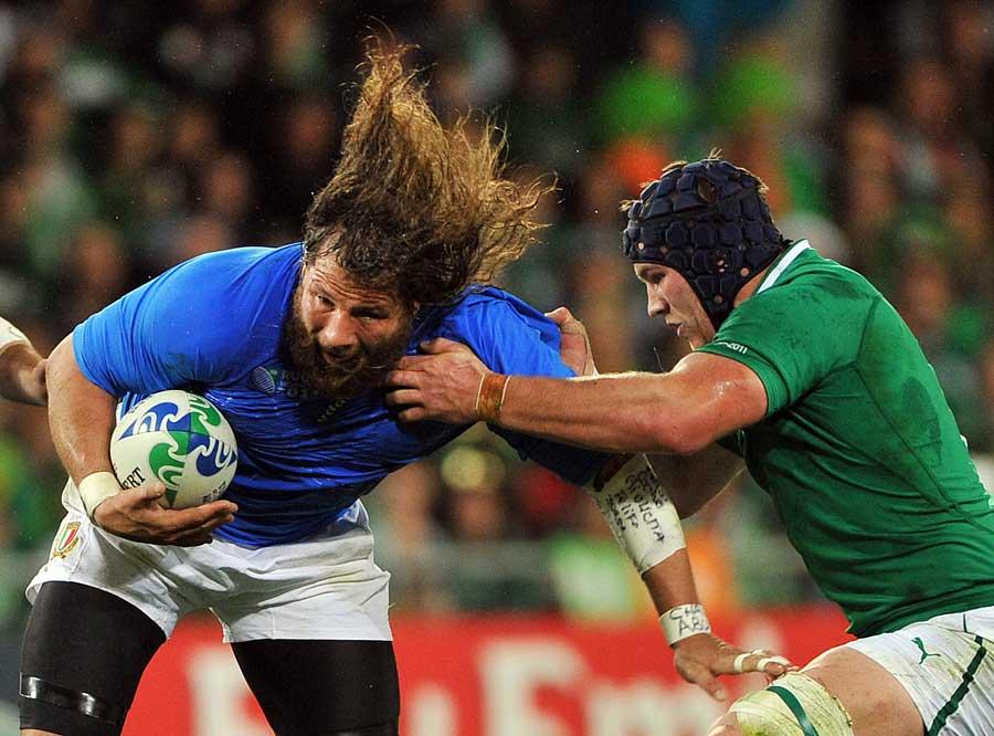 Italy's Martin Castrogiovanni looks to evade the grasp of Sean O'Brien