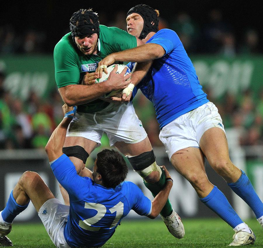 Ireland's Stephen Ferris thunders into the Italian defence