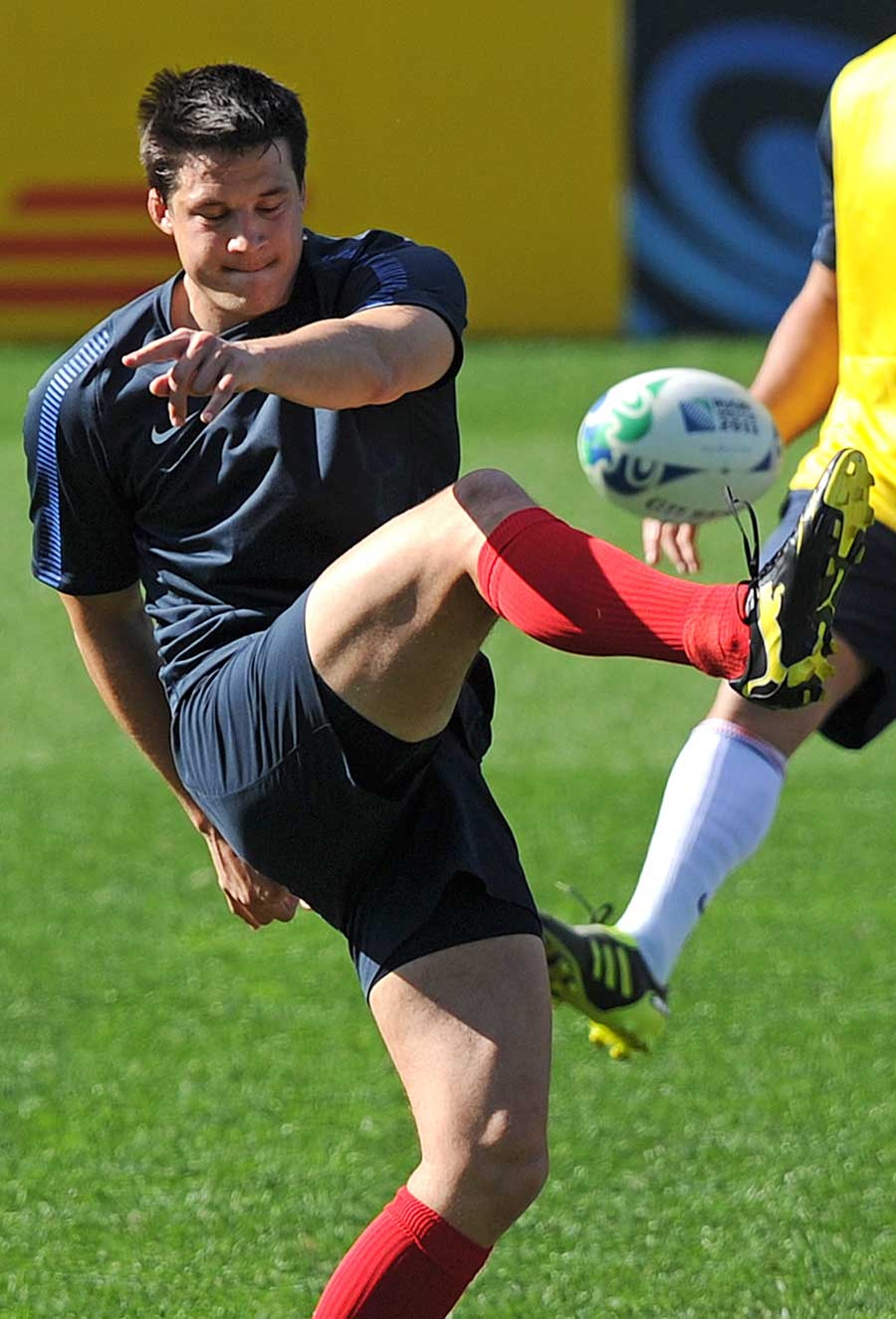 France's Francois Trinh-Duc slices a kick during training