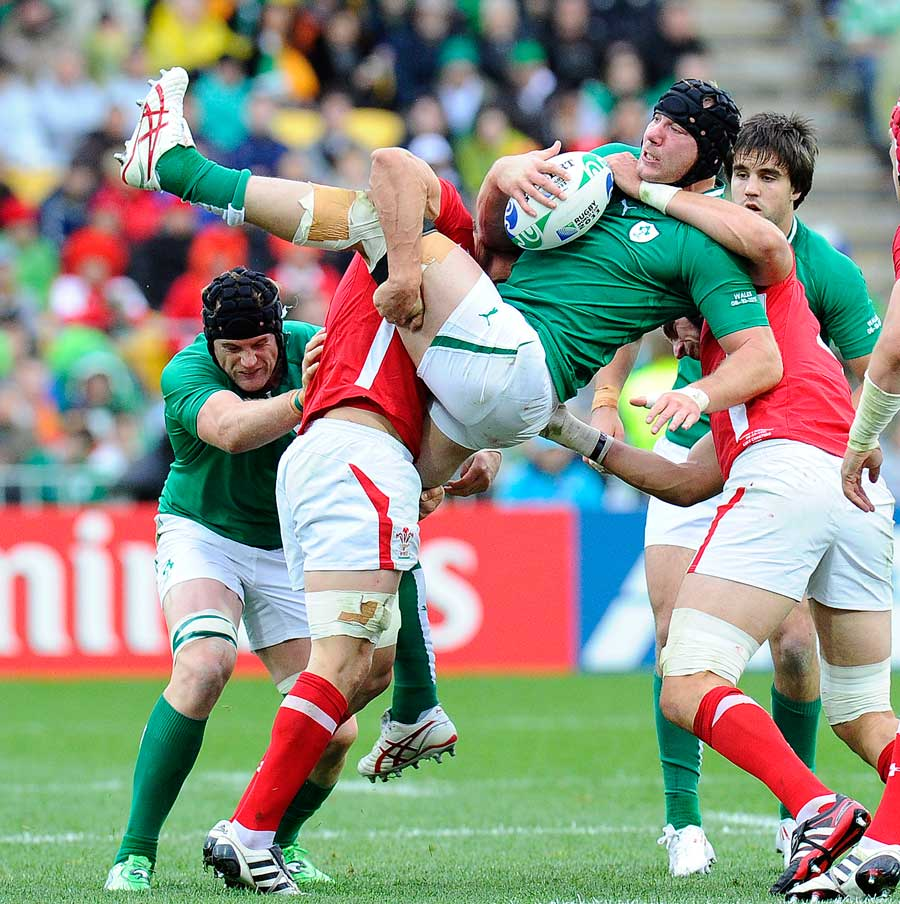 Ireland flanker Stephen Ferris is tackled