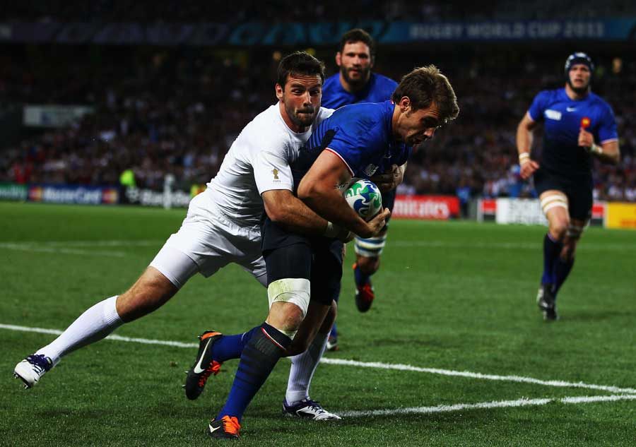 France wing Vincent Clerc powers for the line