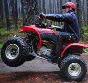Wales' Huw Bennett cracks out a wheelie