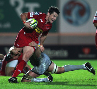 Scarlets centre Rhodri Gomer-Davies breaks a tackle, Scarlets v Leicester Tigers, Anglo-Welsh Cup, Parc y Scarlets, Llanelli, Wales, October 15, 2011